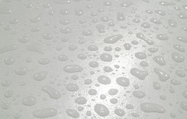 Closeup of water droplets texture on the acrylic tabletop after the rain