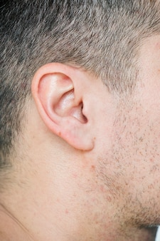 Closeup of white man's ear