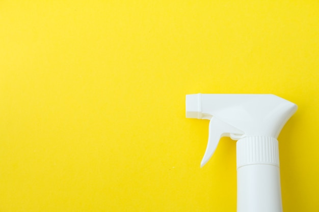 Closeup of white spray  bottle on yellow background set many copy space for put designer design concept