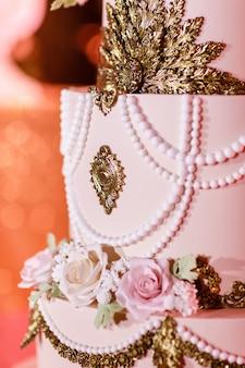 Closeup of white wedding cake with flowers. big wedding cake. decor trends. wedding ceremony.