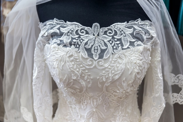 Closeup on white wedding dress on mannequin