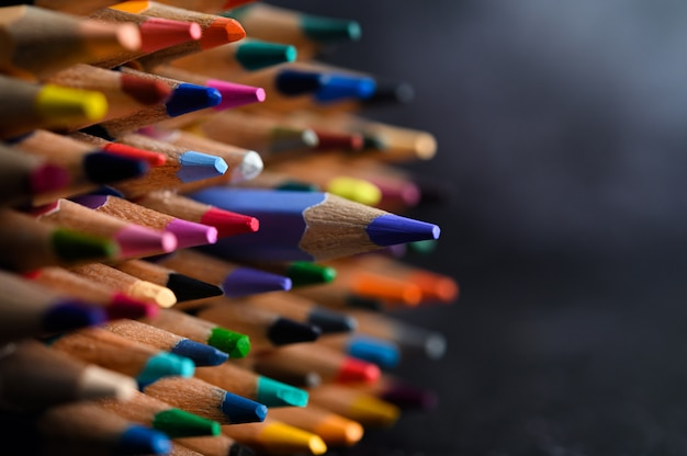 Closeup with a group of colored pencils, selected focus, blue
