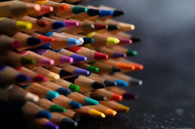 Closeup with a group of colored pencils, selected focus, red
