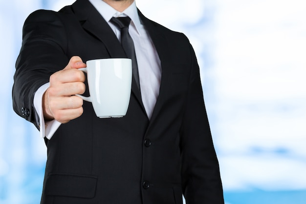 Closeup with hand of businessman holding coffee
