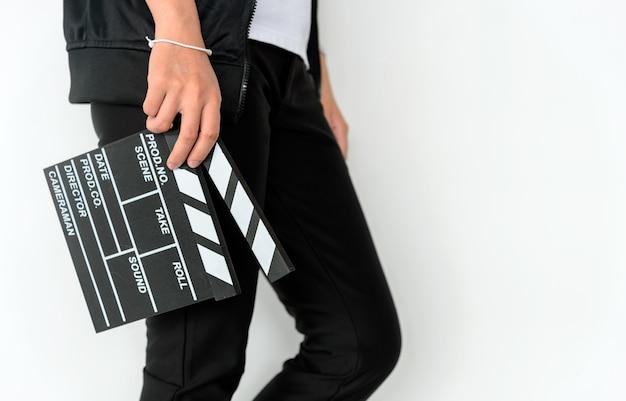 Closeup woman hands holding film clapper