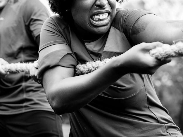 Closeup of a woman playing tug of war