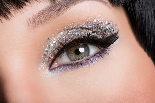 Closeup woman's eye with beautiful fashion bright makeup