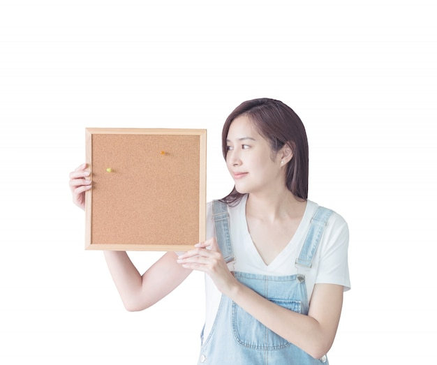 Closeup woman with cork board isolated on white background
