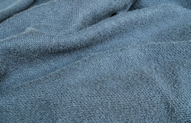Closeup wrinkled blue jacket fabric background