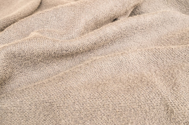 Closeup wrinkled brown jacket fabric