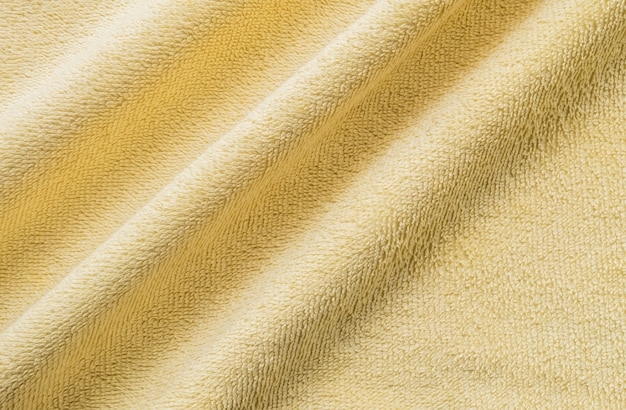 Closeup wrinkled yellow napkin fabric background
