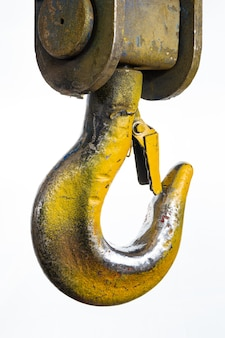 Closeup of a yellow lifting crane hook
