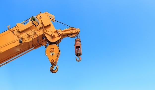Closeup yellow truck crane
