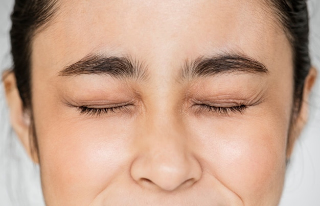 Closeup of young asian girl portrait eyes closed