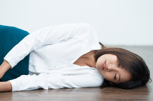 Closeup of young asian woman sleeping on floor