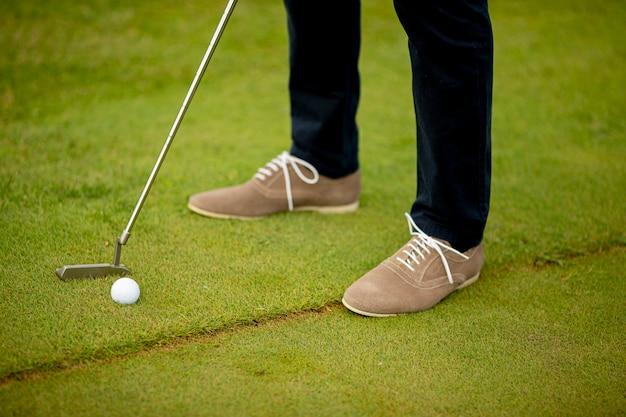 Closeup of young man legs playing golf