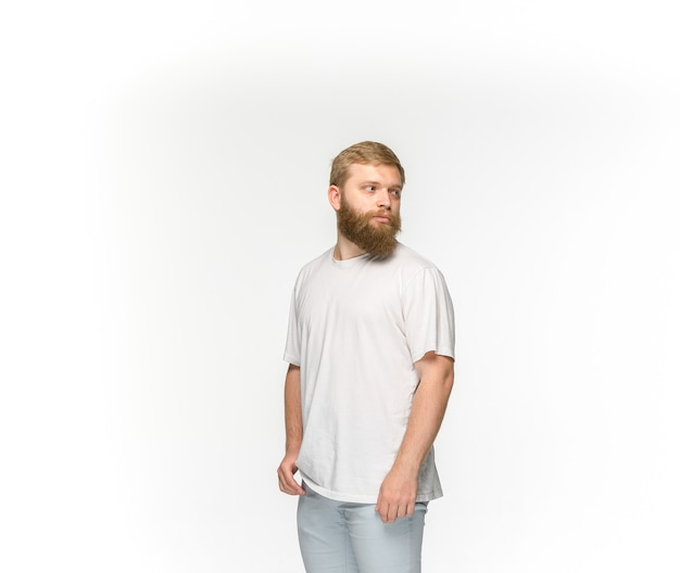Closeup of young man's body in empty white t-shirt isolated on white background. clothing, mock up for disign concept with copy space. front view