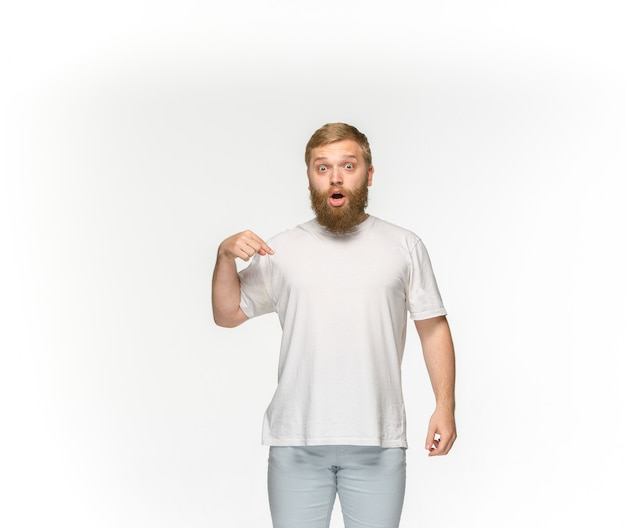 Closeup of young man's body in empty white t-shirt isolated on white space. mock up for disign concept