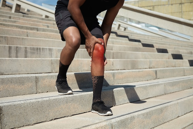 Closeup of young man with knee injury