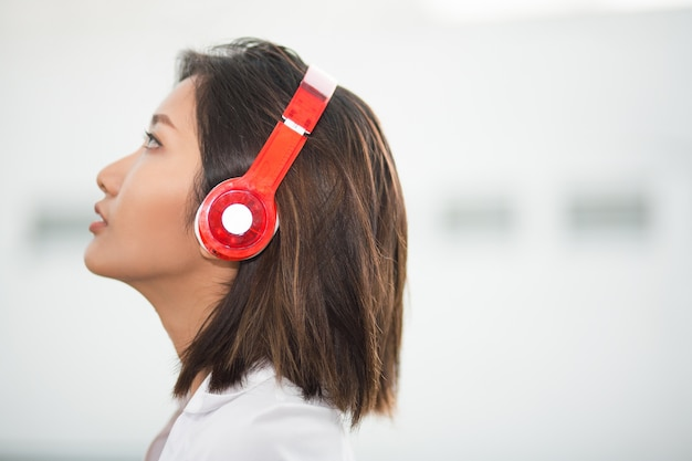 Closeup of young pretty woman listening to music