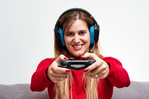 Closeup of a young woman playing video games at home