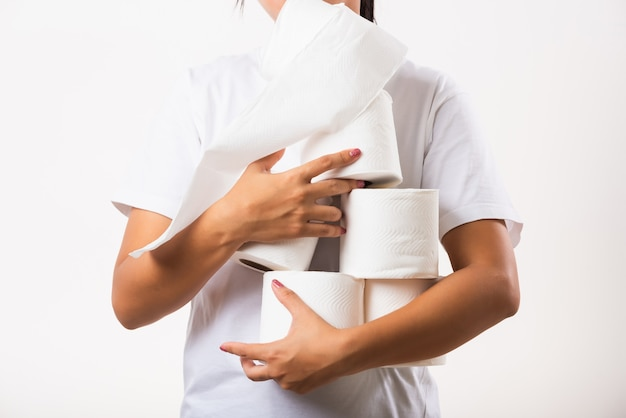 Closeup young woman stocking up toilet paper for home panic in stores quarantine from coronavirus
