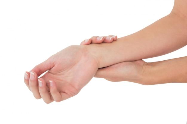Closeup of a young woman touching her wrist