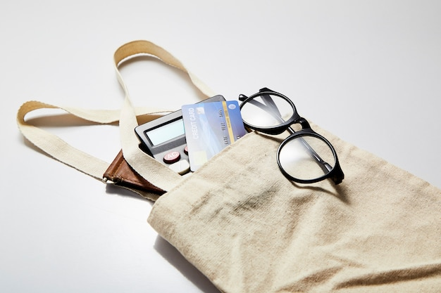 Cloth bag with credit card and purse on white