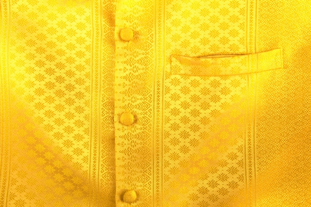 Cloth of gold . fabric made of gold threads interwoven with silk or wool.