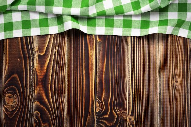 오래된 나무 보드 테이블 배경의 천 냅킨, 위쪽