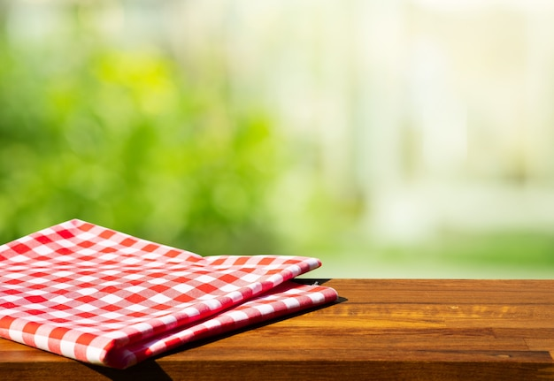 Cloth napkin on wood table with glass window background