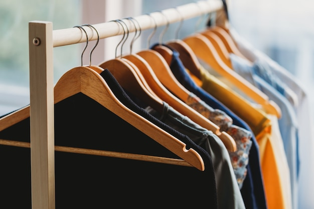 Clothes are hung on shelves at the store