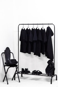 Clothes, bag and shoes all in black dressing room