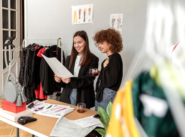 Clothes designers working at store