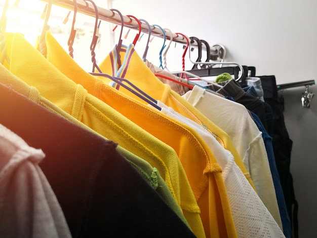 The clothes hanging on clothing rack.