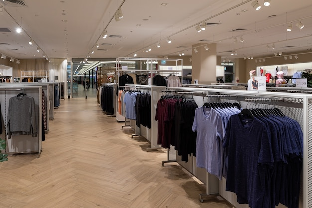 Clothes in interior of fashion shop.