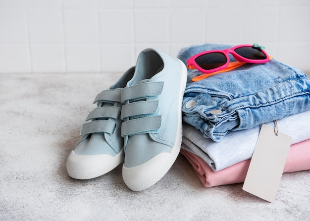 Clothes for kids in an open cardboard box. online shopping concept. delivery of clothes.