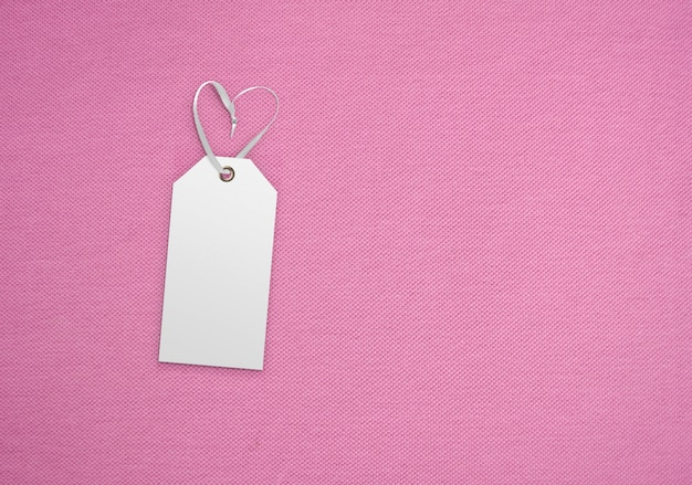 Clothes label tag on cloth background. branding template mockup