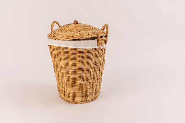 Clothes in a laundry wooden basket isolated