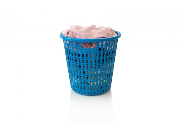 Clothes in a laundry wooden basket on white background