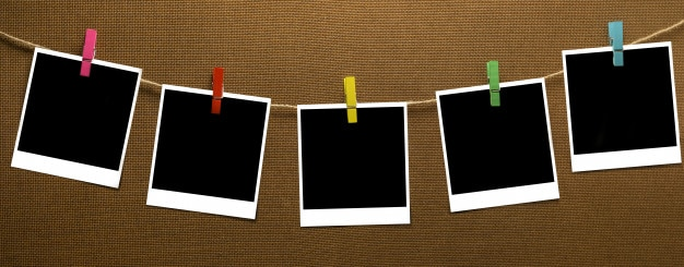 Clothes line hanging instant photo on wood board