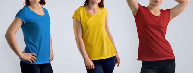 Clothes mockup set with fit female model in the color t-shirt isolated on the studio background, front view. includes three color schemes: red, blue, yellow. template for your showcase.