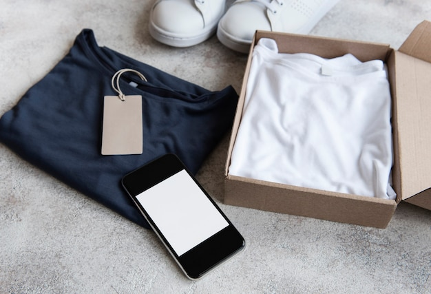 Clothes in an open cardboard box. online shopping concept. delivery of clothes.