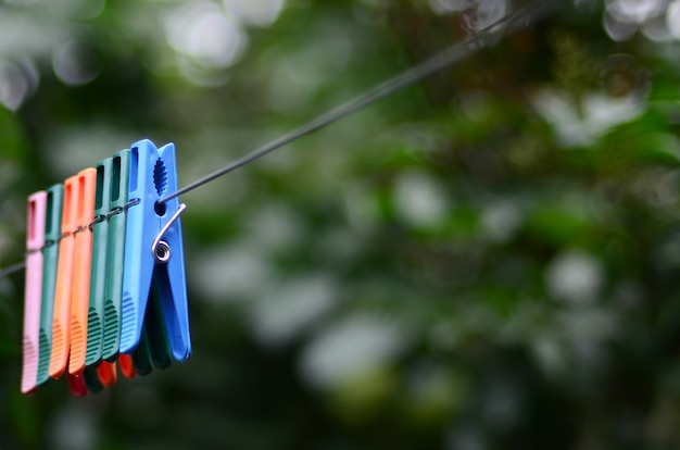 Clothespins on a rope hanging outside