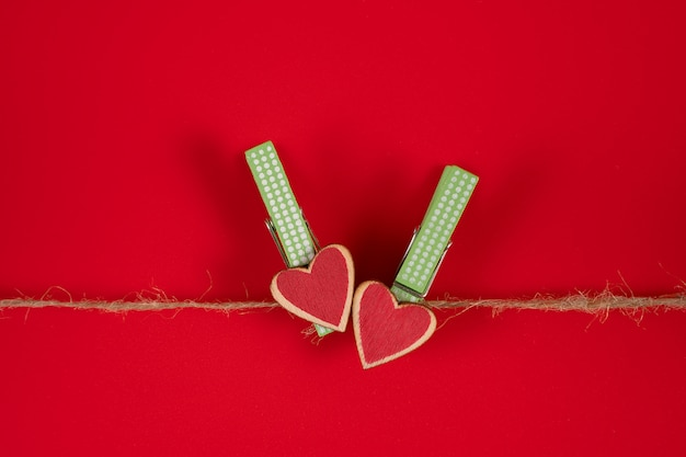 Clothespins with hearts on a rope