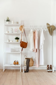 Clothing in trendy color hangs on a rack with accessories