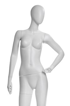 白い背景で隔離の白で隔離の服の女性のマネキン