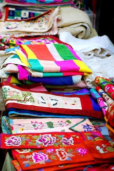 Cloths of embroidered silk and linen in asian market