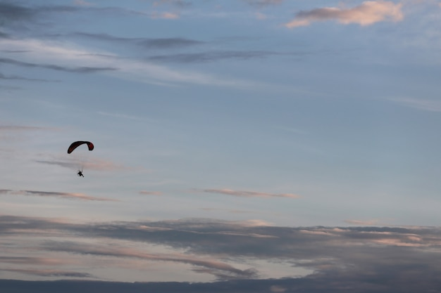Cloud on blue sky and paramotor sport.