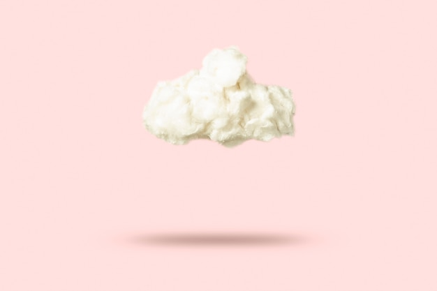 Cloud of cotton wool on a pink background. weather concept.